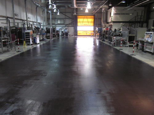 Conductive layer encapsulating grid and floor surface