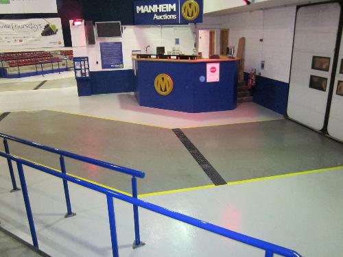 Slip resistant seamless epoxy garage showroom flooring