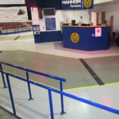 Slip resistant seamless epoxy garage showroom flooring